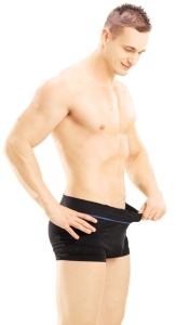 24298296-Young-shirtless-man-looking-in-his-pants-isolated-on-white-background-Stock-Photo